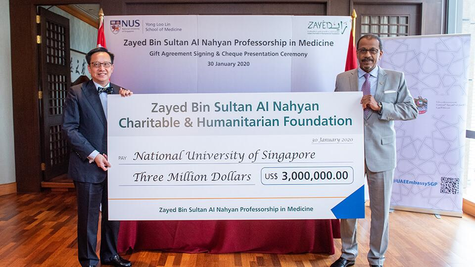 Professor Chong Yap Seng, Dean of the NUS Yong Loo Lin School of Medicine (left) and and His Excellency Dr Mohamed Omar Balfaqeeh, Ambassador of the United Arab Emirates to Singapore (right), at the agreement signing ceremony for the Zayed Bin Sultan Al Nahyan Professorship in Medicine